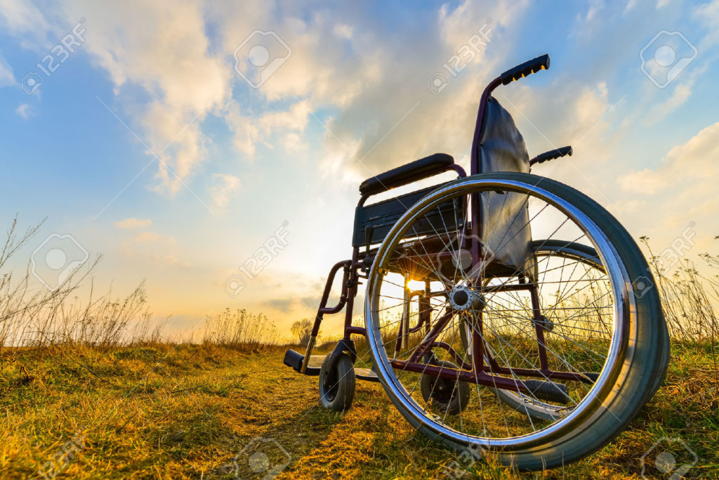 39158634-Empty-wheelchair-on-the-meadow-at-sunset-Miracle-concept-Healed-person-raised-and-went-away-Stock-Photo